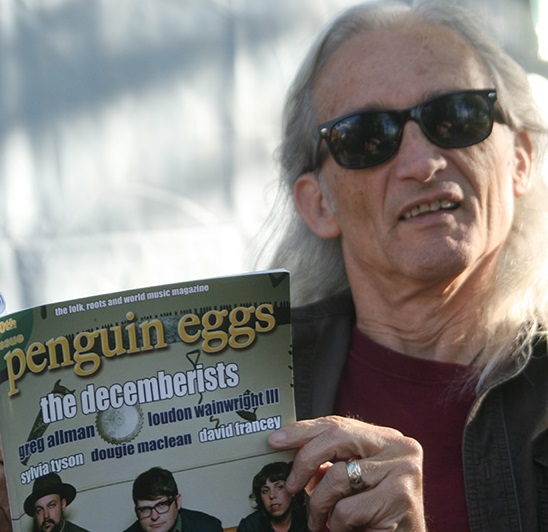 Jimmy Dale Gilmour kicks back with a read of Penguin Eggs before going on stage