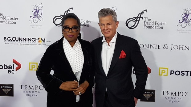 Oprah with David Foster on stage in Vancouver on Saturday evening