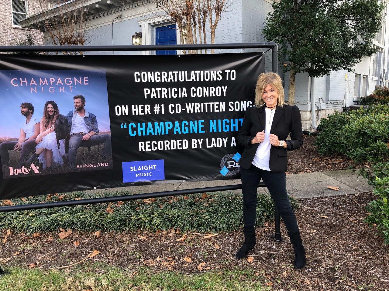 Patricia Conroy clearly tickled pink standing outside her publisher's office in Nashville.