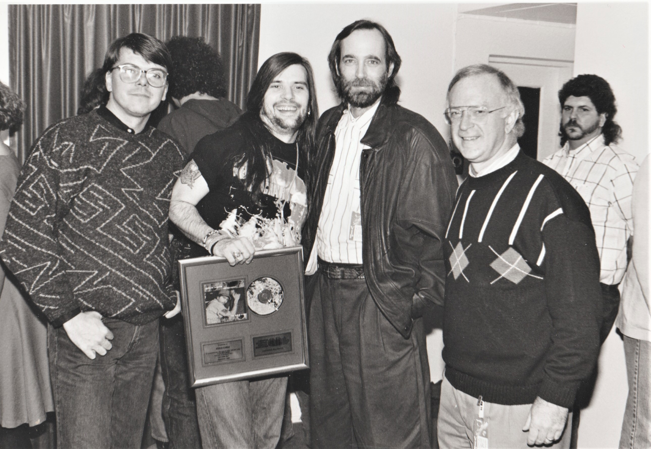 Randy Lennox, Steve Earle, Stephen Tennant, and MCA topper Ross Reynolds in Nov. 1980.