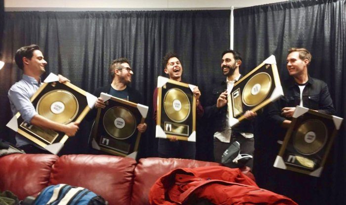 Members of Arkells receive gold plaques at hometown show