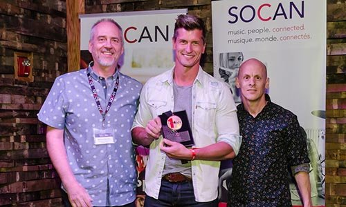 """Brad Rempel (centre) of High Valley receives a SOCAN No. 1 Song Award for """"Come On Down,"""" flanked by SOCAN's Michael McCarty (left) and Rodney Murphy (right). Photo: Kerry Woo Photography"""