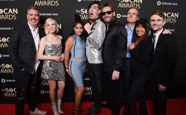 Ed Robertson, Carly Rae Jepsen, Jessie Reyez, Josh Ramsay, Chad Kroeger, SOCAN's Eric Baptiste, Buffy Sainte-Marie and Tavish Crowe celebrate The SOCAN Awards on the red carpet  (photo CNW/SOCAN)