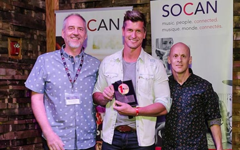 "Brad Rempel (centre) of High Valley receives a SOCAN No. 1 Song Award for ""Come On Down,"" flanked by SOCAN's Michael McCarty (left) and Rodney Murphy (right). Photo: Kerry Woo Photography"