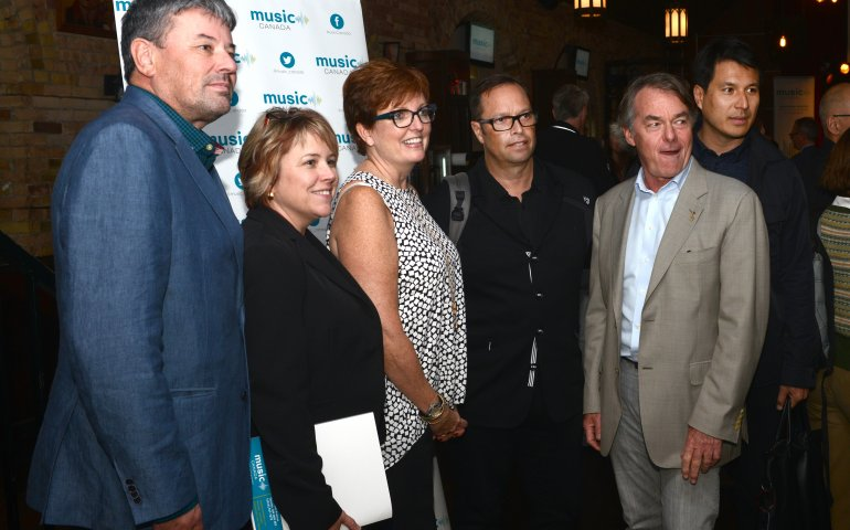 Ontario Culture Minister Eleanor McMahon (centre) flanked by (l-r) Warner president Steve Kane, Music Canada EVP Amy Terrill, Sony president Shane Carter, Music Canada president Graham Henderson, and UMC president Jeffrey Remedios. The event was MC''s AGM at Revival in Toronto on Tuesday. -- Picture credit: Gunter Kravis