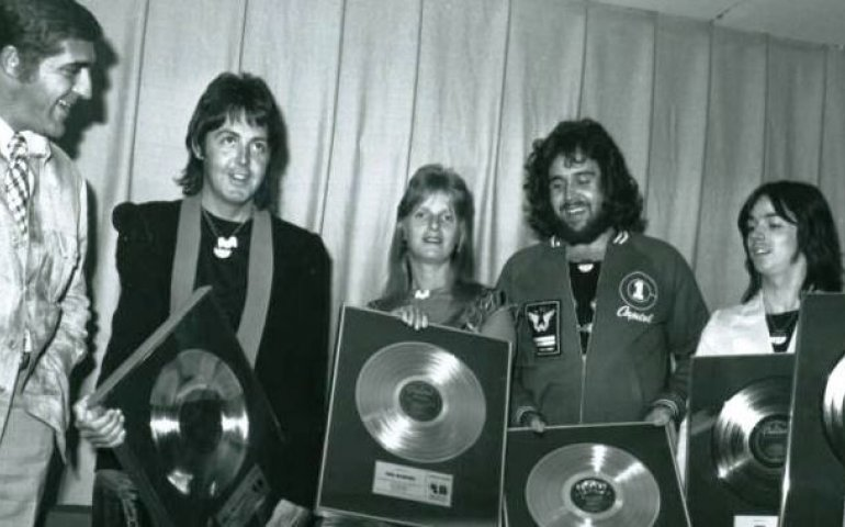 Paul & Linda McCartney with Wings and Capitol-EMI president Arnold Gosewich circa 1972. The photo is included as part of the archives donated to the U of Calgary.