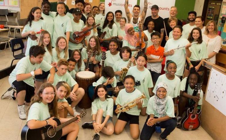 Hedley and Queen Alexandra Middle School students celebrate their Band Aid grant