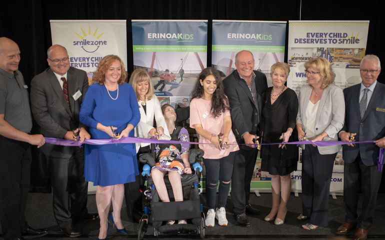 Alessia Cara (centre) helps cut the ribbon    416 Kings Photography