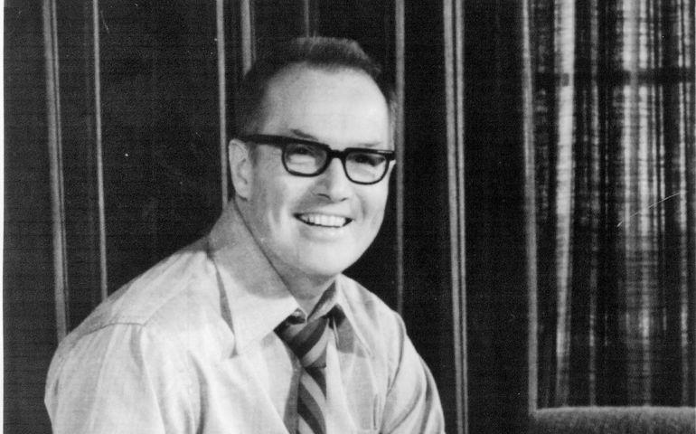 Allan Waters, circa 1970, sitting on his desk