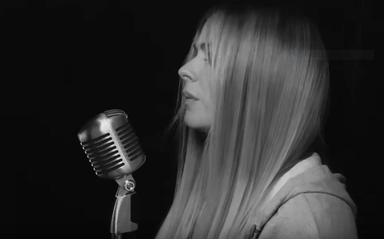 Avril screenshot from her music video for We Are Warriors.