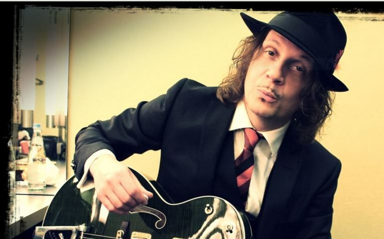 Canadian musician  Adrian Raso, who has a song in the film... Website image