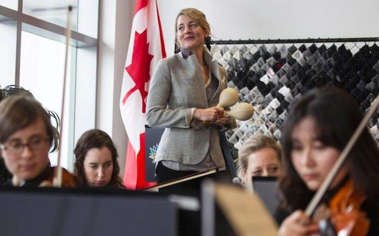 Heritage Minister Mélanie Joly playing the maracas