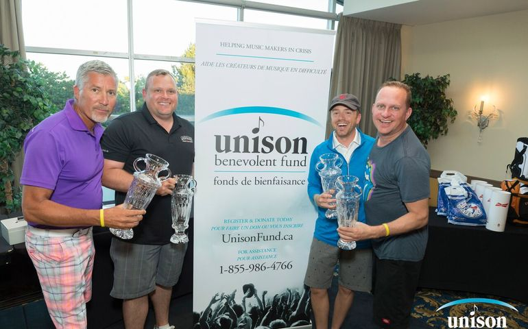Slaight Music's Derrick Ross (l) with CEC Golf Classic winning team, Black Box Music. Photo: Barry Roden