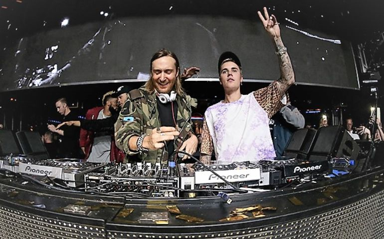 David Guetta and Justin Bieber spinning in the command booth