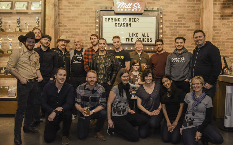 Seen here at the Mill St. Brew Pub in Toronto are performers Dick Rodan, Sam Drysdale and Marlon Chaplin along with key members of the Mill St., WWF Canada and Indie Week teams.