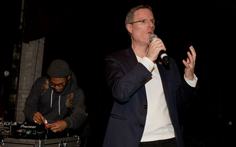 Kaytranada sets up while SOCAN CEO Eric Baptiste addresses the audience at the 2017 Canada @ The Grammys party, co-presented by SOCAN in LA.