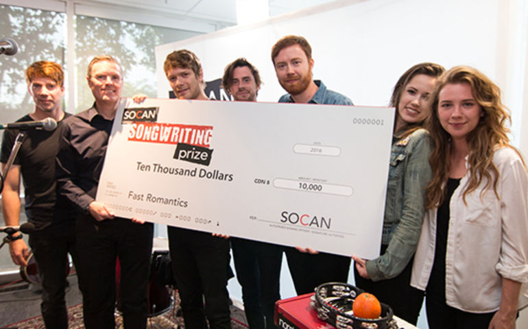2016 Prize winners Fast Romantics receive cheque from SOCAN's Eric Baptiste