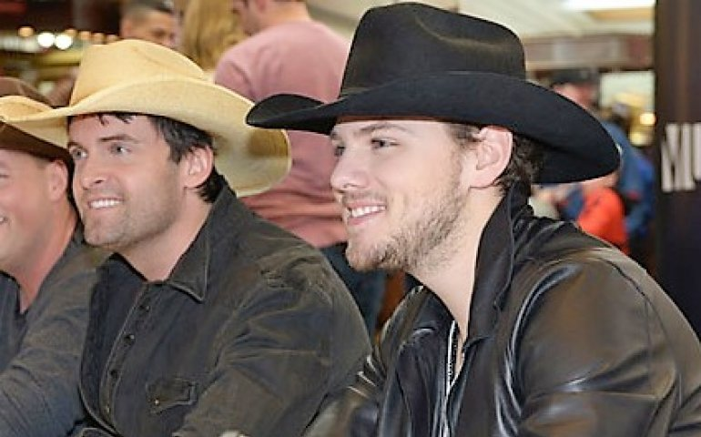 Dean Brody (l) and Brett Kissel. Photo: CARAS/iPhoto