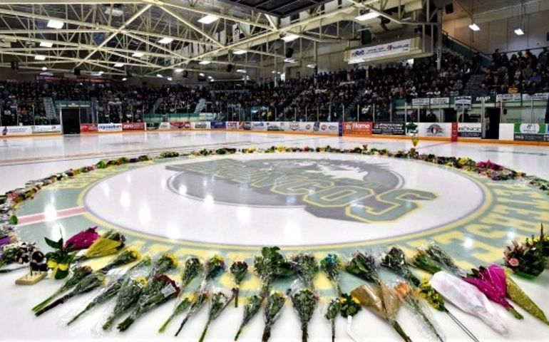 Flowers centre ice at Elgar Petersen arena, home of the Humboldt Broncos. Pic - Jonathan Hayward, CP