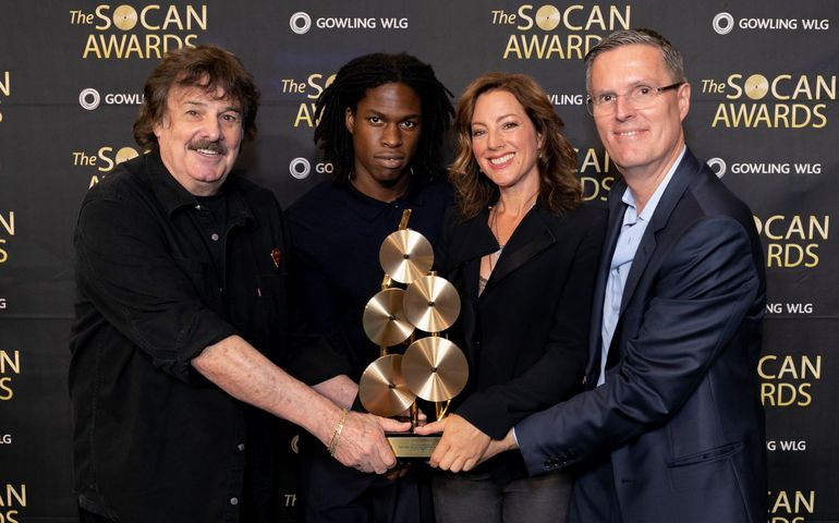 L-R: SOCAN Lifetime Achievement Award winner, Burton Cummings;  Breakout Artist winner, Daniel Caesar;  Global Inspiration winner, Sarah McLachlan; and SOCAN CEO, Eric Baptiste.