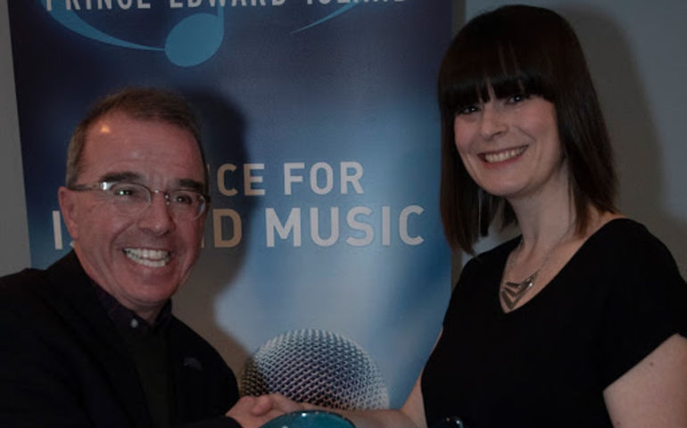Rachel Beck receives the Pop Album of the Year Award from Charlottetown Mayor Phillip Brown.