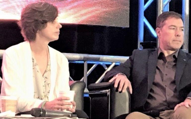 Rogers' Julie Adam with Corus's Troy Reeb.
