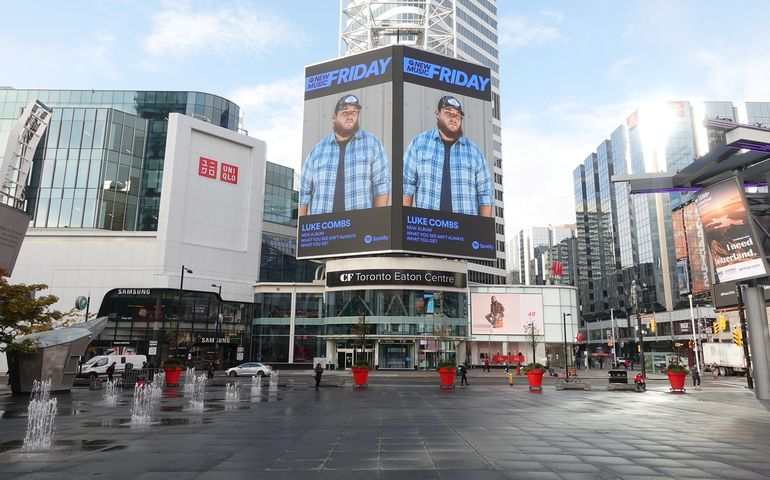 Old fashioned marketing: Luke Combs ad hangs overtop Toronto Eaton Centre