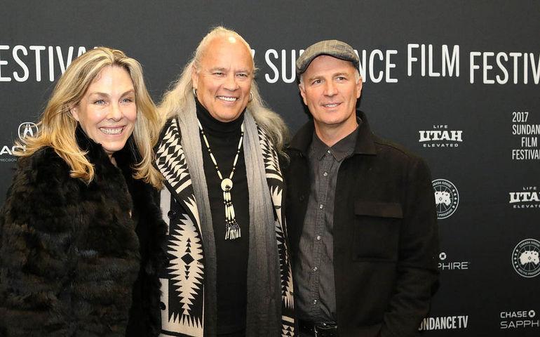 Lynyrd Skynyrd guitarist Rickey Medlocke (centre) with directors Catherine Bainbridge and Alfonso Maiorana