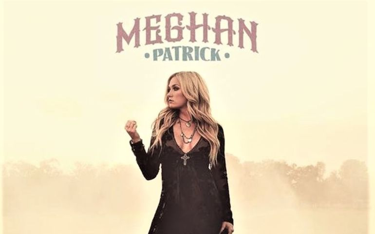 "Meghan fisting ""Country Made Me Do It"" on her album cover"