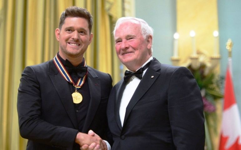 Governor General David Johnston presents Michael Bublé with the National Arts Centre Award during the Governor General's Performing Arts Awards ceremony at Rideau Hall in Ottawa.