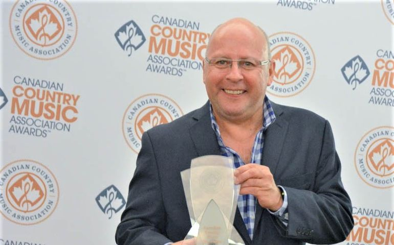 Mike Denney with one of his many CCMA awards
