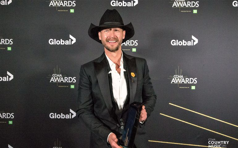 Slaight Music Humanitarian Award winner Paul Brandt backstage at the CCMAs