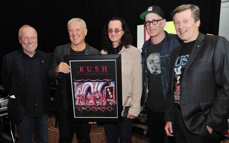 Gary Slaight with Alex and Geddy from Rush holding their Allan Slaight Humanitarian Award. Also pictured here are Polaris Music Prize founder Steve Jordan; and Toronto Mayor John Tory.