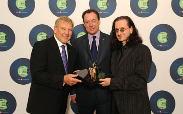 Rush (Alex Lifeson, Neil Peart and Geddy Lee) was a Modern Era inductee to the Canadian Songwriters Hall of Fame in 2010