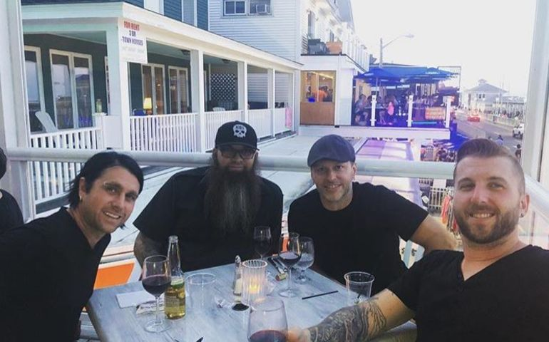 Three Days Grace chill from the road on the boardwalk in Hampton Beach, New Hampshire. Pic: Instagram