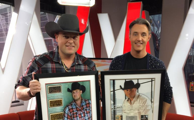 Gord Bamford (l) receiving his plaques alongside Ben Mulroney