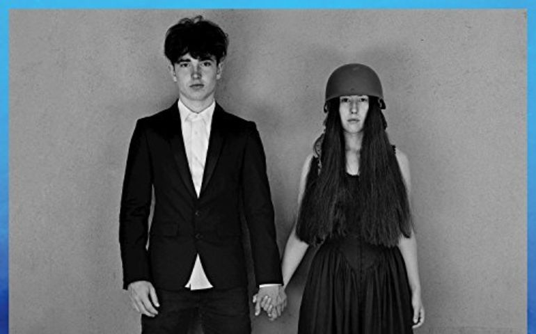 U2 album cover depicts Bono's son Eli and The Edge's daughter Sian holding hands.