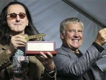 Geddy Lee (left) and Alex Lifeson of Rush were presented with a key to the city by Toronto mayor John Tory this weekend. The two also had an art park named after them at the event on Saturday (September 17) honoring their achievements over forty years in the music industry.