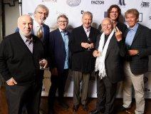 Gee7 CIMA Summit: Bernie Finkelstein, photographer Bill King, Rik Emmett, Al Mair, Gil Moore, Neill Dixon and Richard Flohil testing the wind direction with his finger.