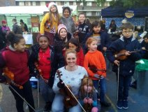 Gillian Mott with her busking violin students