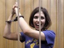 Pussy Riot's Nadezhda Tolokonnikova (nicknamed Nadya Tolokno), behind bars during a court hearing in Moscow. The three member all-woman band was detained on Feb. 21, 2012, after they stormed into Moscow's main cathedral to sing a protest song against Vladimir Putin and criticised the Russian Orthodox Church's support for Putin.