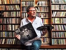 Warner topper Steve Kane pictured in front of his collection in the Globe & Mail yesterday.