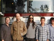 Gord Downie (2nd from left) with his mates in front of the tour bus