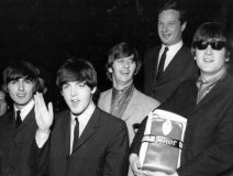Earlier inductee the late Brian Epstein with his boys