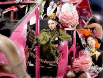 "Grimes as Mad Max, from her ""Kill V. Maim"" video. The Canadian electro-pop artist is headed for Glastonbury"