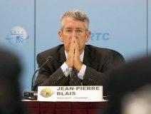 Jean-Pierre Blais praying at a hearing