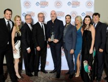 Robert Ott (centre) holds ole's CCMA Award, surrounded by his team