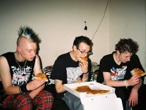 Proof of the pudding: Punks chowing down on pizza fresh out of the box
