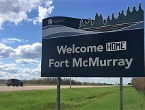 Chris Byrne, one of the few residents allowed back into the city before the evacuation orders were lifted, decided to make the temporary change to the city's welcome sign. Source: CBC News
