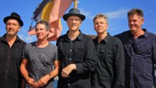 Midnight Oil aboard the Mari Nawi for a global reunion tour announcement press conference. Pic Jenny Evans